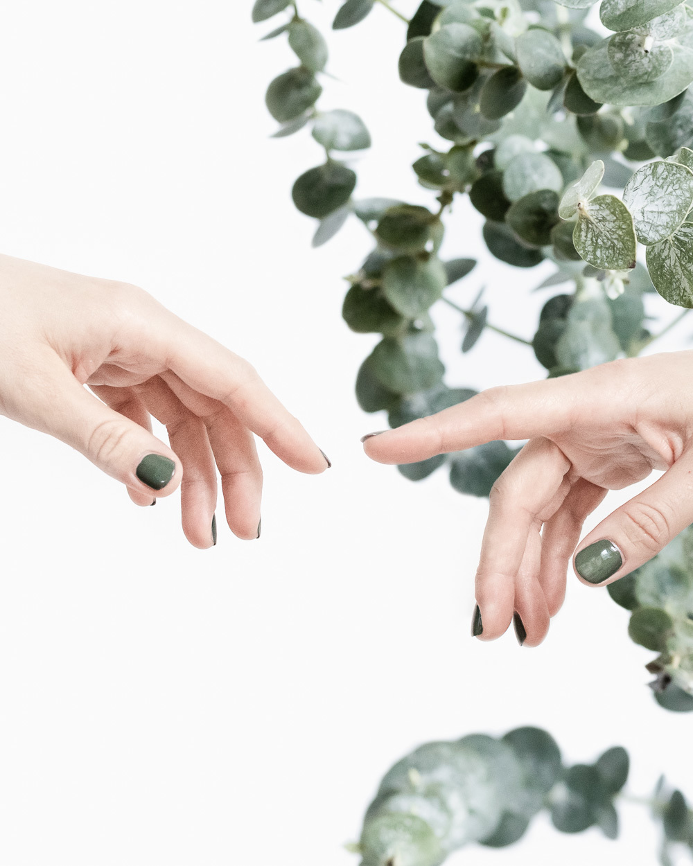 Two female hands touching fingers as the Creation painting - by The Product Stylist